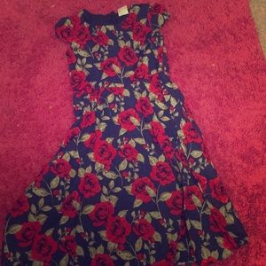 A blue dress with roses for a 9-10 year old